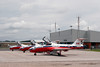 Canadair CT-114 Tutor. Snowbirds #5, 8 and 9 sitting on the ramp with the main terminal in the background.