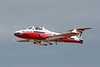 A close up of Canadair CT-114 Tutor Snowbird number 7 while flying by the Dryden Regional Airport.