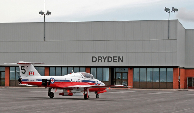Snowbird #5 sits in front of the Dryden Regional Airport terminal.