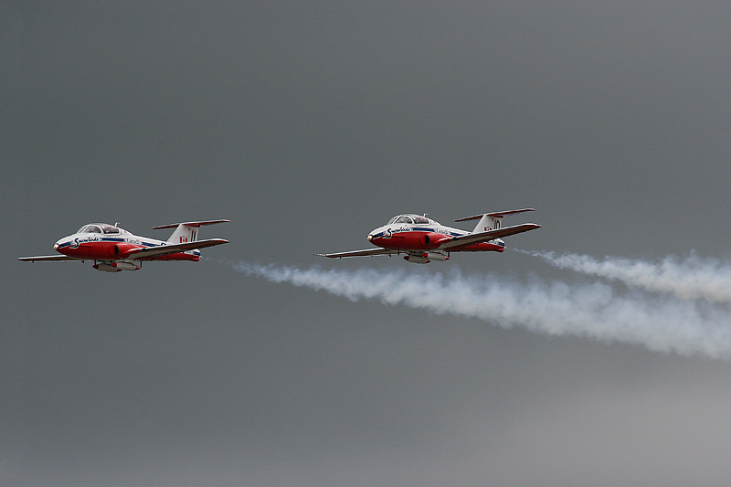 2 of the Canadian Snowbirds (Numbers 10 and 11) on a fly by at the Dryden Regional Airport.<br /> <br /> All 11 of the Snowbirds landed at the Dryden Airport for fuel, and to wait out weather on their way to the Thunder Bay Airport for a airshow that was to happen the next day.