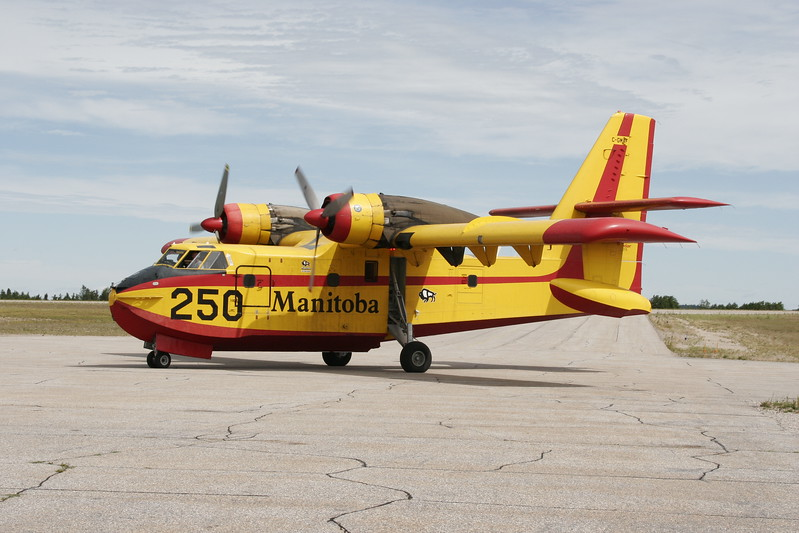 A CL-215 operated by the Province of Manitoba looks for a place to park on Ramp 'A' in Dryden