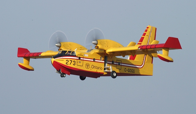 CL-415 Tanker 273 on a overshoot. The landing gear is just being retracted.