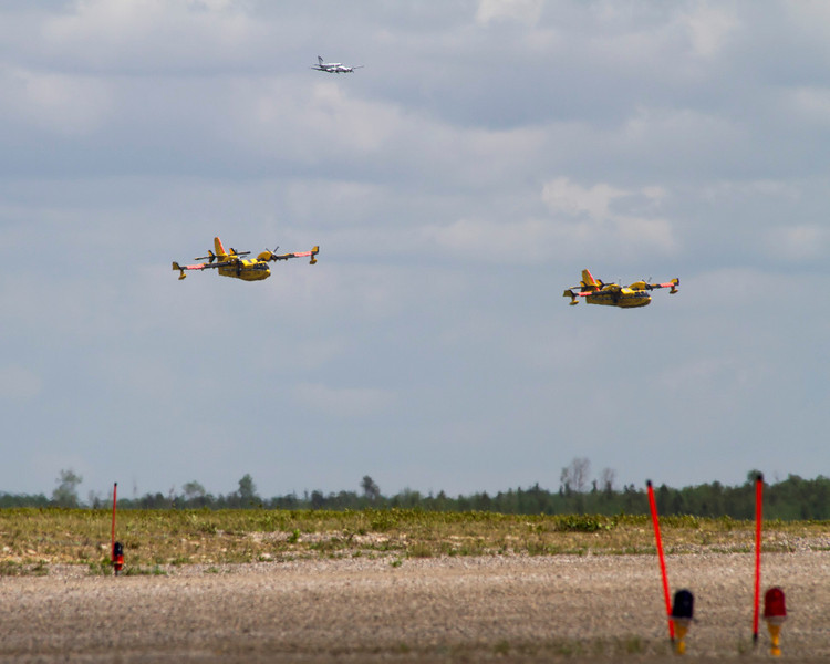 The three aircraft appear unsharp as we are looking at them through the heat waves coming off of the ground.