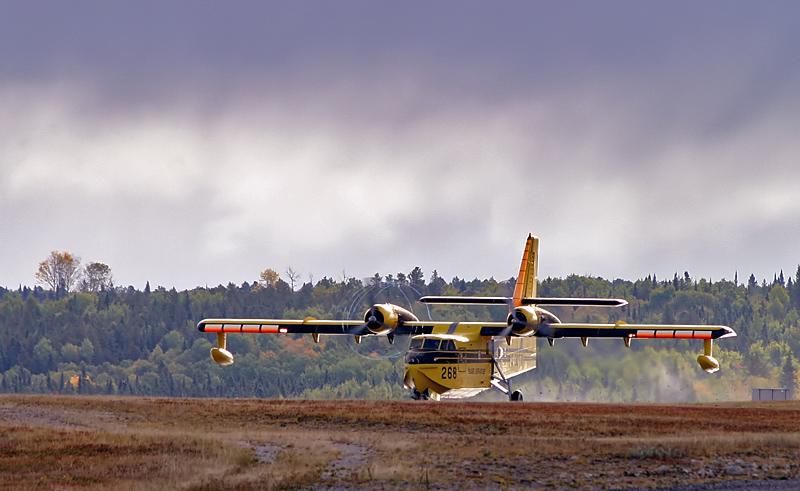 Air Spray Tanker 268 On Take Off Runway 29 at Dryden Regional Airport.