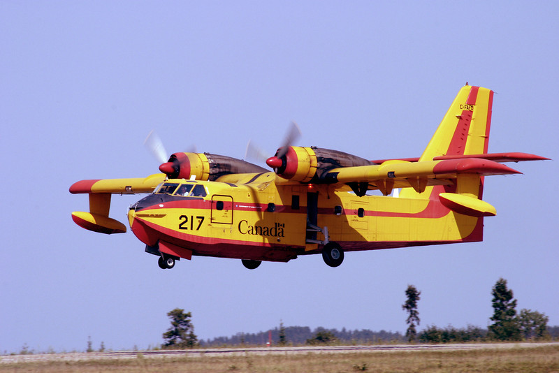 This CL-215 is operated by the Province of Saskatchewan. Just after take off from runway 29.