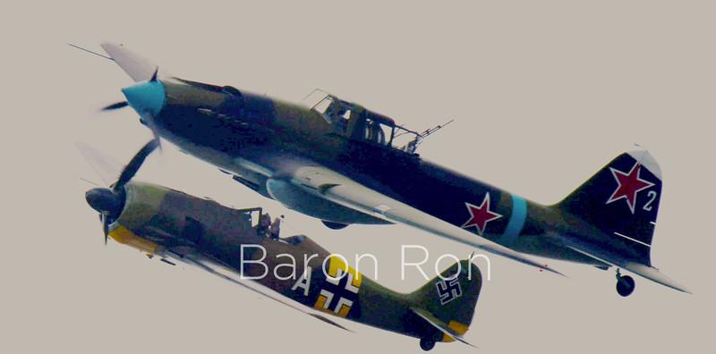 "Ilyushin ""Shturmovik"" Soviet Ground-attack Bomber above the German Focke-Wulf 190 Fighter"
