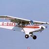 PA-18 150 G-BAKV landing at Thruxton c.1998