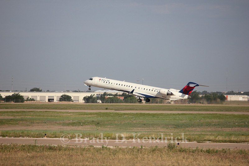 Airline:  Delta Air Lines<br /> <br /> Aircraft Type:  Bombardier CRJ700<br /> <br /> Photo Location:  Rick Husband International Airport in Amarillo, Texas