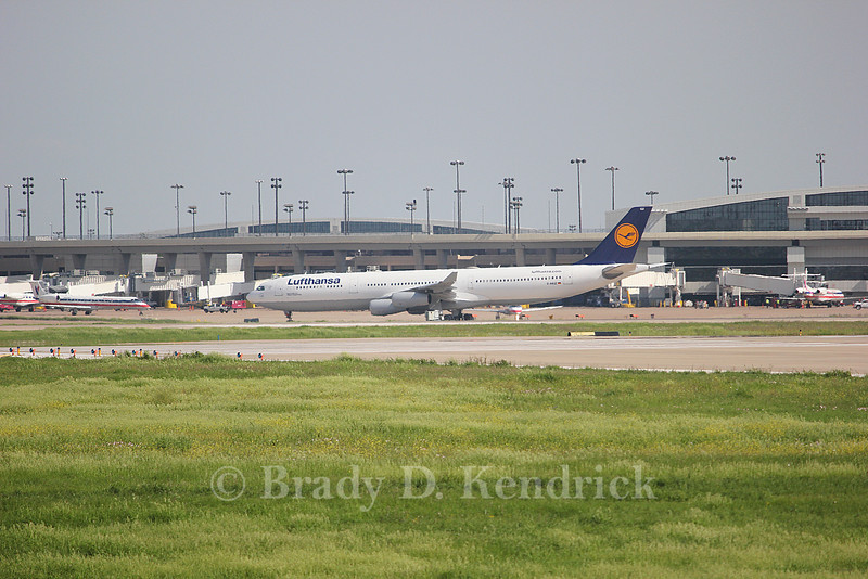 Airline:  Lufthansa<br /> <br /> Aircraft Type:  Airbus A340<br /> <br /> Photo Location:  Dallas Fort Worth International Airport in Fort Worth, Texas