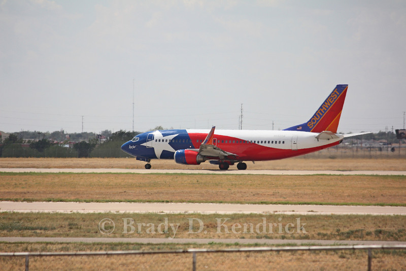 Airline: Southwest Airlines<br /> <br /> Aircraft Type: Boeing 737-300<br /> <br /> Special Note: Lone Star State paint job<br /> <br /> Photo Location: Rick Husband International Airport in Amarillo, Texas