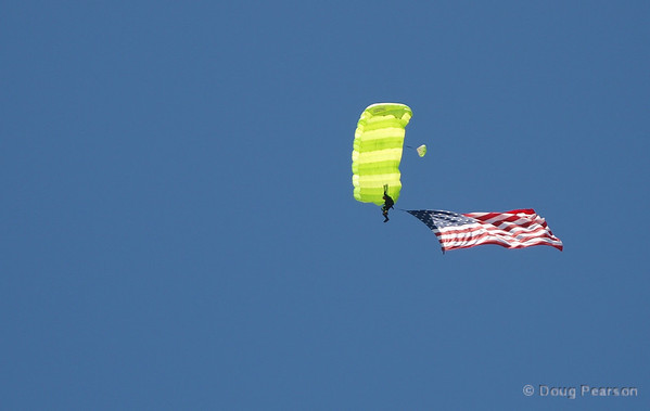 Parachutist with US Flag landing at 2009 Heroes Airshow Los Angeles