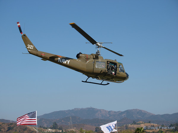 A Vietnam era Huey painted as Navy 321 leaving Hansen Dam fom American Heroes Air Show 2010