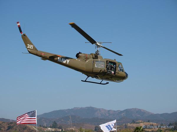 A Vietnam era Huey painted as Navy 321 leaving Hansen Dam fom American Heroes Air Show 2010