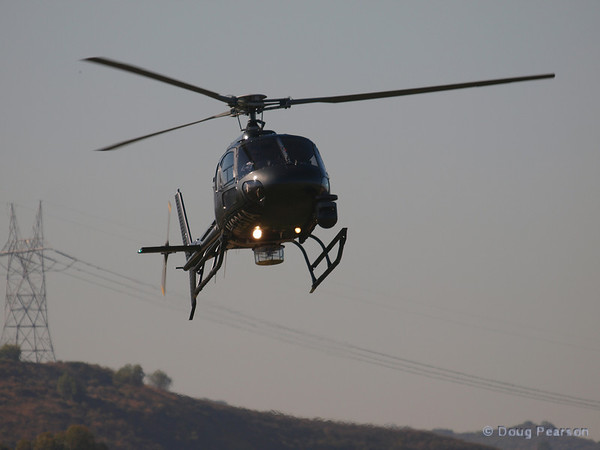 """On approach to Hansen Dam for American Heroes Airshow 2012; N1231A, a Eurocopter AS 350 B2 helicopter known as """"Sky 2"""" for KCBS in LA."""