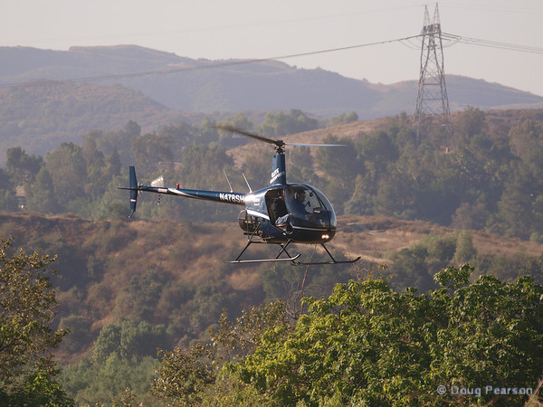 N91AV a Robinson R44 landing at Hansen Dam for American Heroes Air Show 2012.