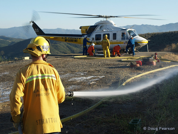 LA County, LA City and Ventura County Helicopters working a Helispot to reload with Water and Fuel.  LA County Copter 20 pictured.