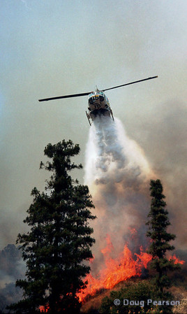 LA County Copter 15 drops on a fire in Brand Park, Glendale.  July 4th, 1995.