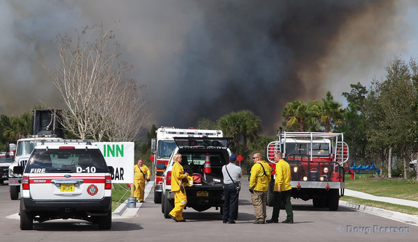 A command post is set up for a brush fire in Titusville, FL