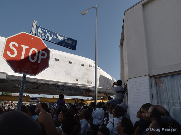 As Endeavour made her way home, all traffic was stopped for the crowds.