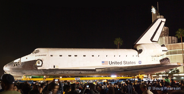 Endeavour waiting to proceed down Martin Luther King Blvd in Los Angeles while the crowds get a close up view.