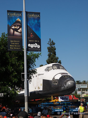 Along the crowded streets, Endeavour passes a California Science Center Ad for another exhibit.