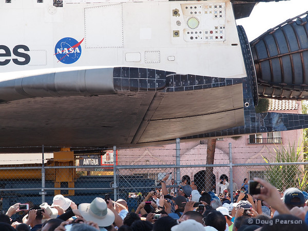 As Endeavour makes the final trip, she provides some much needed shade for the crowd.