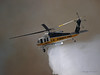 LA County Copter 19 works a Brush fire near Travel Town in Griffith Park, Los Angeles, CA