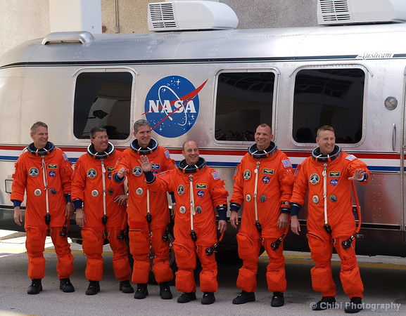 STS-132 crew members, from left, British-born, U.S. astronaut Piers Sellers, Stephen Bowen, Michael Good, Garrett Reisman, Dominic Antonelli, and Kenneth Ham, share a laugh as they pose for a photo after leaving the Operations and Checkout Building for a trip to launch pad 39-A and lift off on the space shuttle Atlantis Friday. Kennedy Space Center FL. May 14, 2010