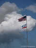 US Flag and Atlantis Flag flying with the Contrail of STS-132. May 14, 2010