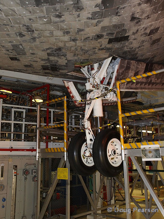 The front landing gear of Space Shuttle Discovery. Taken April 27, 2011 in Orbiter Processing Facility 2 at KSC.