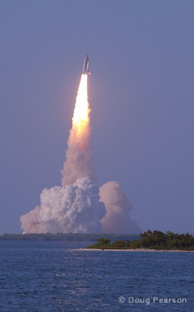 Discovery starts roll maneuver after liftoff on STS-133