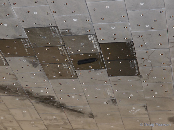 The bottom of Discovery's left wing shows some newer tiles and the sensors used to document re-entry conditions.
