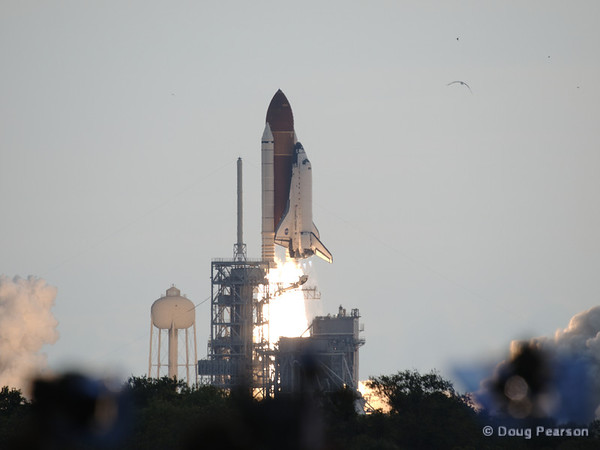 Space Shuttle Endeavour (OV-105) clears the tower. Launching on mission STS-134 to deliver the Alpha Magnetic Spectrometer experiment to the International Space Station.