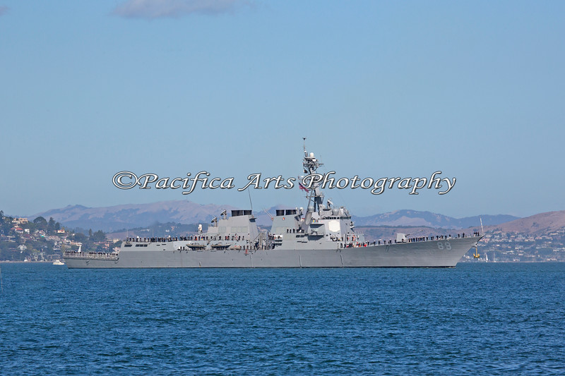 "With her crew standing at the railing, the ""USS Preble"" cruises in the San Francisco Bay."