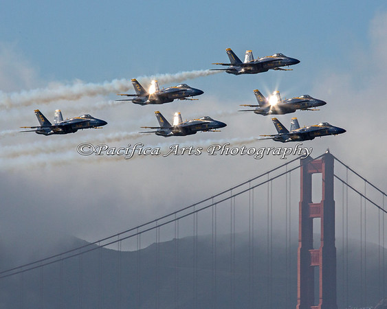 The sun beginning to set in early in October, and reflecting off of the Blue Angels as they fly over the Golden Gate Bridge.  The fog (of course) is rolling in. (2012)