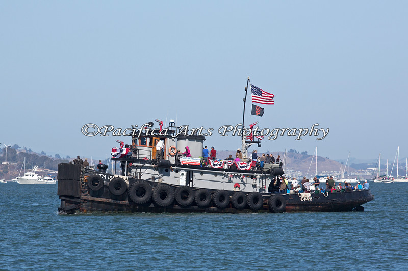 """The """"USS Mazapeta"""", an Historic WWII Tugboat/Fireboat, was originally launched in 1943, and is 100 feet long.   For more history on this vessel: http://www.sftugboats.org/index_files/Page501.htm"""