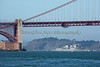 The USS Preble (DDG-88) cruises in under the Golden Gate Bridge.  Her length is almost 510 feet, and is a Arleigh Burke-class destroyer in the United States Navy.  She is manned by 30 Officers and 270 Enlisted personnel.