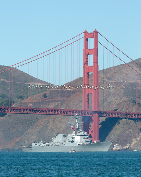 USS Spruance (DDG-111), an Arleigh Burke-class Guided Missile Destroyer, passes under the Golden Gate Bridge during Fleet Week's Parade of Ships. She is 510 feet in length and her displacement is 9200 tons.