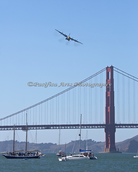 Fat Albert is a USMC C-130T Hercules aircraft, used to carry spare parts, equipment and support personnel for the Blue Angels.  Here, Fat Albert circles around the Golden Gate Bridge. (2012)