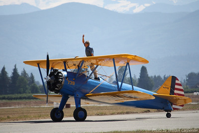 John Mohr waves to the crowd after a thrilling display in his stock Stearman biplane.