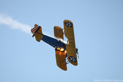 John Mohr flies his stock Stearman during the 2010 Abbotsford International Air Show. The vintage engine in his Stearman isn't set up for inverted flight, so it stalls out and belches flame during inverted maneuvers before restarting after the airplane is righted.