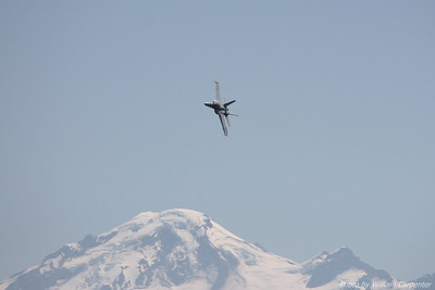 A US Navy F/A-18E Superhornet flies a demonstration flight at the 2010 Abbotsford International Air Show. Mount Hood is in the background.