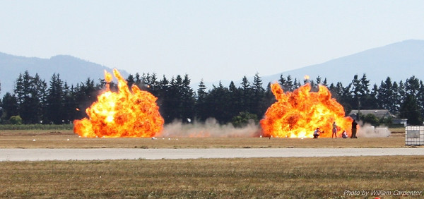 Pyrotechnics simulate bombs dropped from two CF-18 Hornets during the Canadian Forces simulated field assault at the 2010 Abbotsford International Air show.