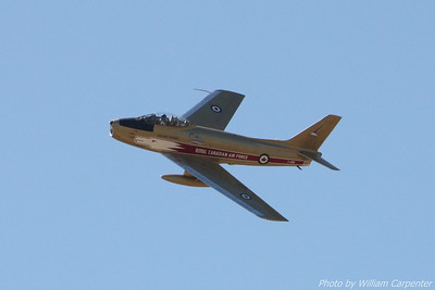 """Hawk One"", a Canadian F-86 Sabre painted in the colors of the CAF Golden Hawks demo team, flies a demo at the Abbotsford International Air show."