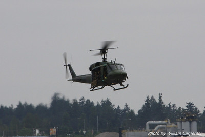 A huey prepares to deploy troops in a simulated airfield assault.