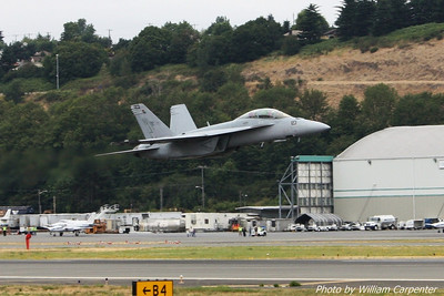 An F/A-18F Superhornet takes off to perform its demo flight over Lake Washington.