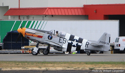"The P-51 Mustang, ""Impatient Virgin?"", taxis to the end of runway 31L."