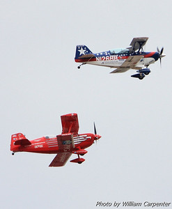 Two aerobatic aircraft heading out to Lake Washington.