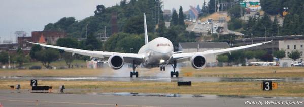 A Boeing 787 lands.