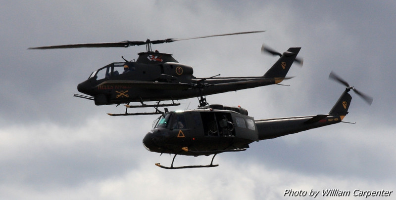 A Huey and a Cobra, both from the Olympic Flight Museum, take part in a Vietnam reenactment.